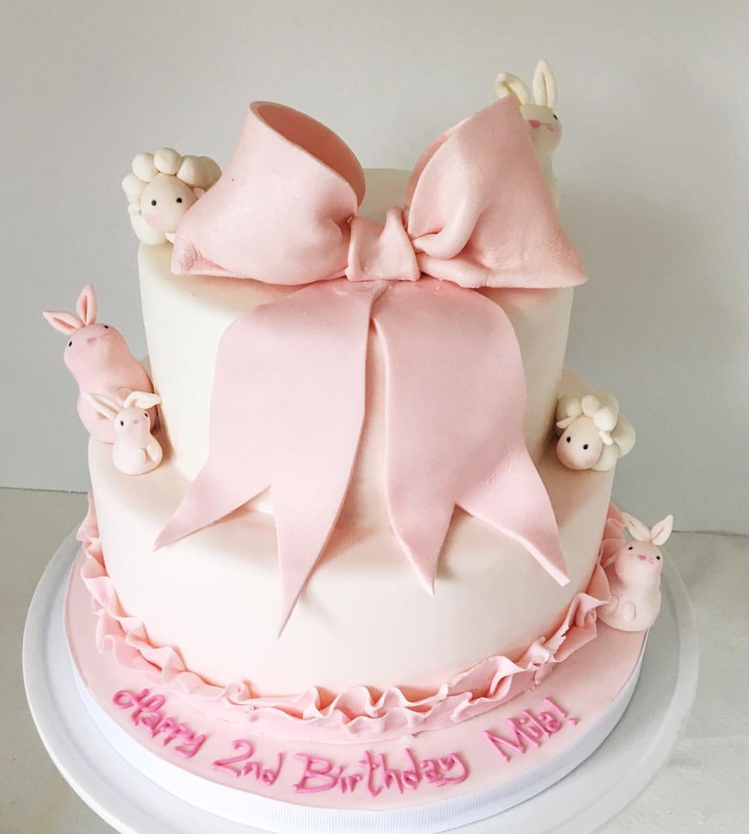 Pink and white bow birthday cake