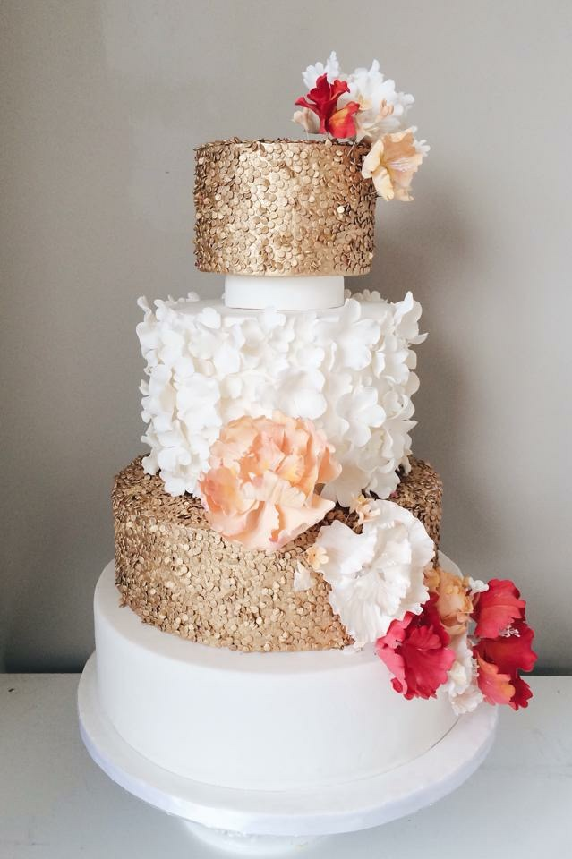 Gold and white ruffle wedding cake with sugar flowers
