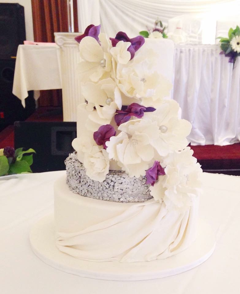 White and silver sparkle wedding cake with sugar flowers