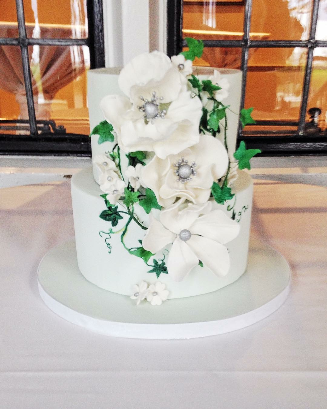Pastel green wedding cake with sugar flowers