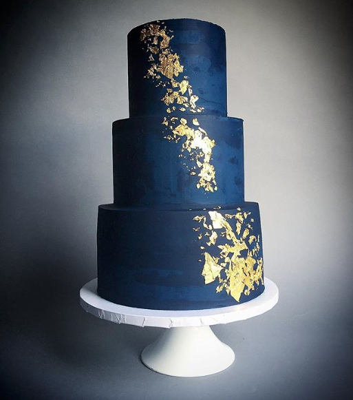 Navy blue fondant wedding cake with gold leaf