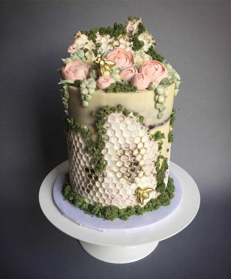 Ivory and white honeycomb textured wedding cake