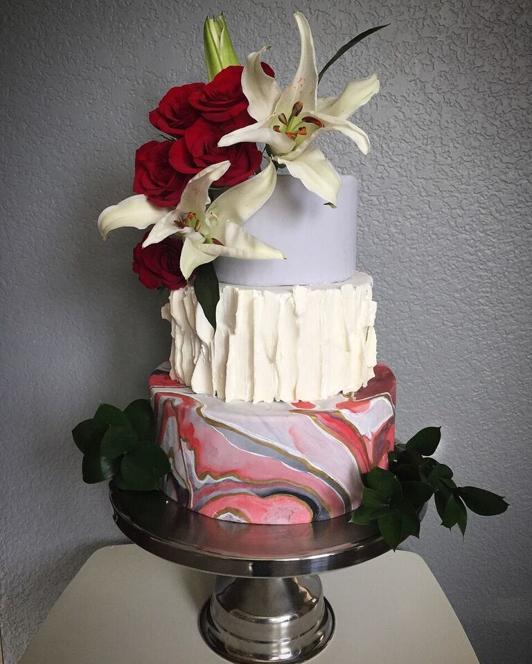 Light purple and red marble wedding cake with sugar flowers