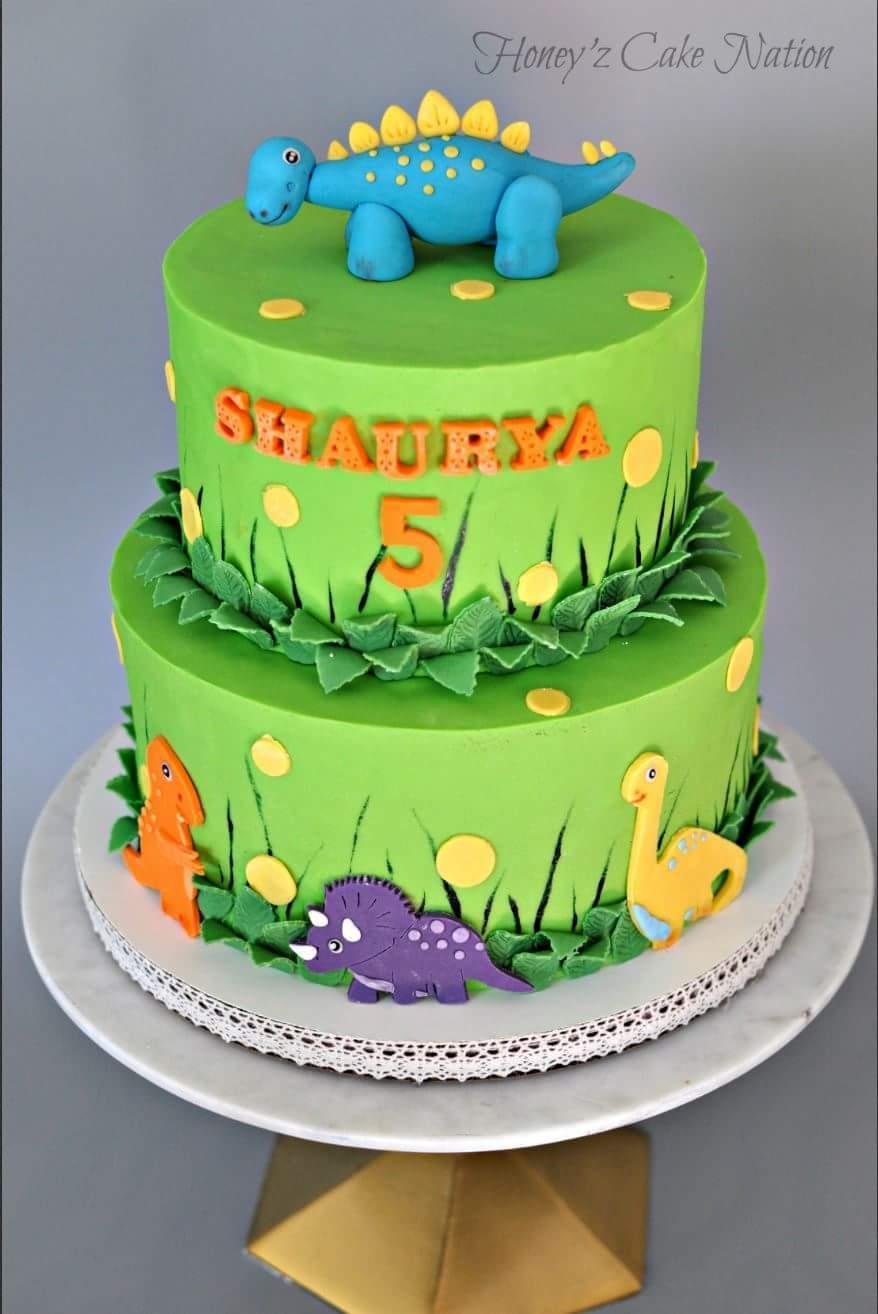 Green fondant cake with dinosaur topper