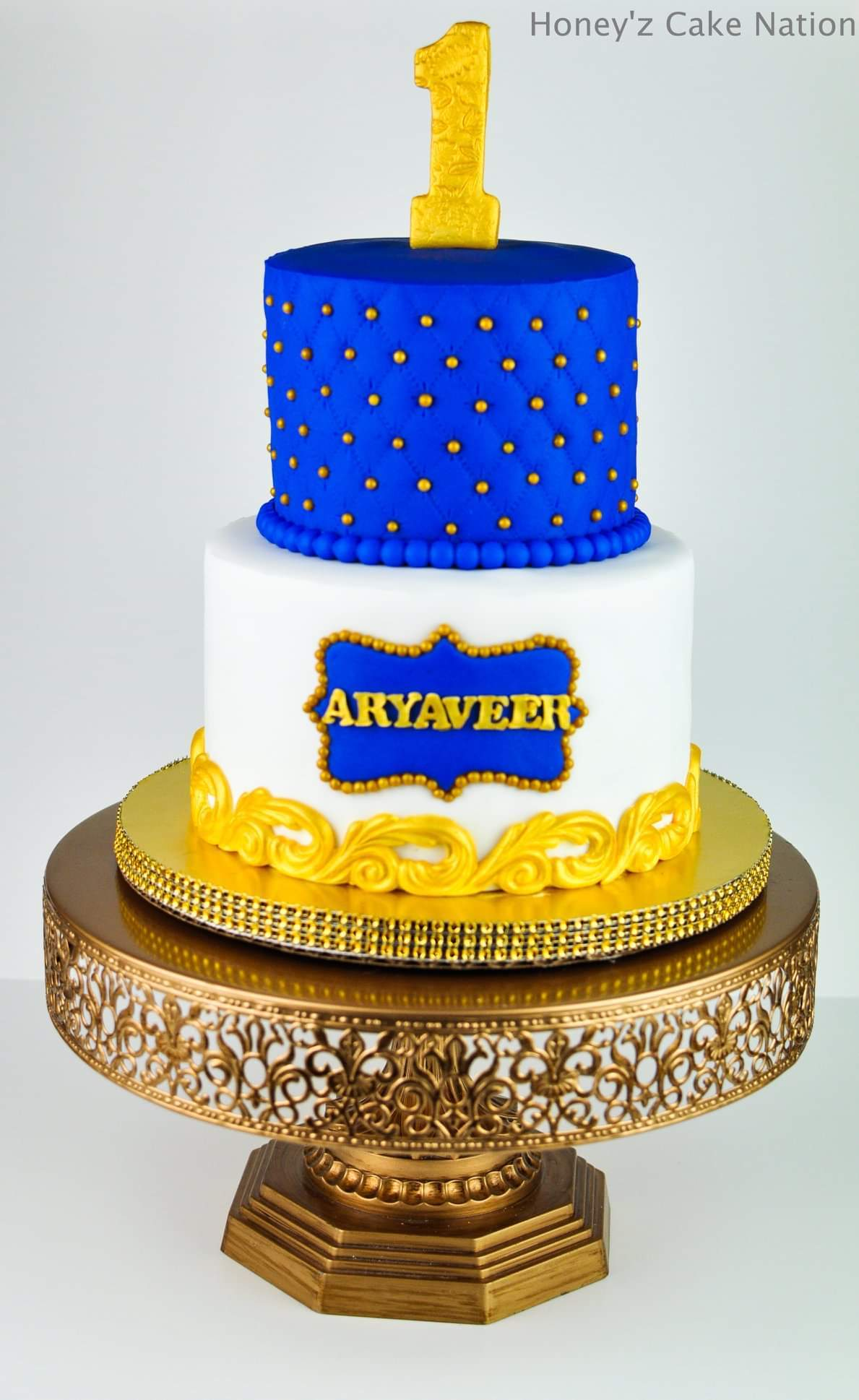 Blue and yellow 1st birthday cake