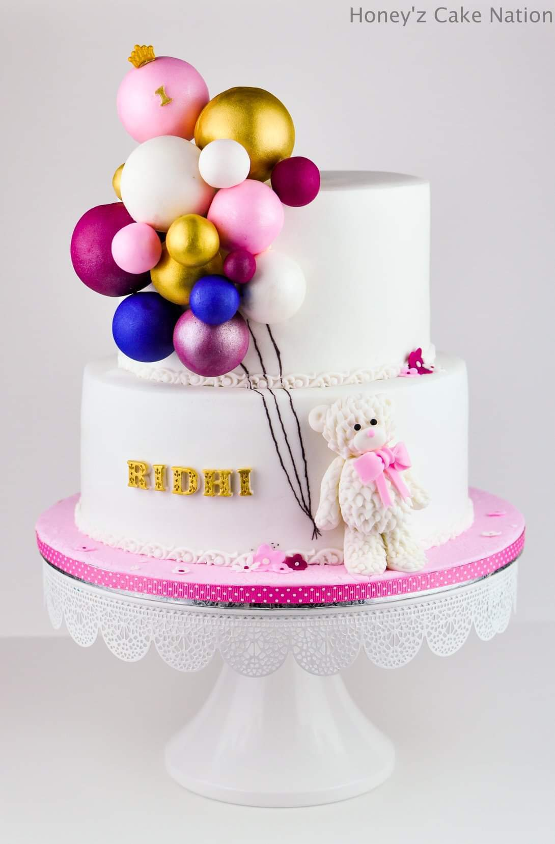 White and pink baby bear fondant cake