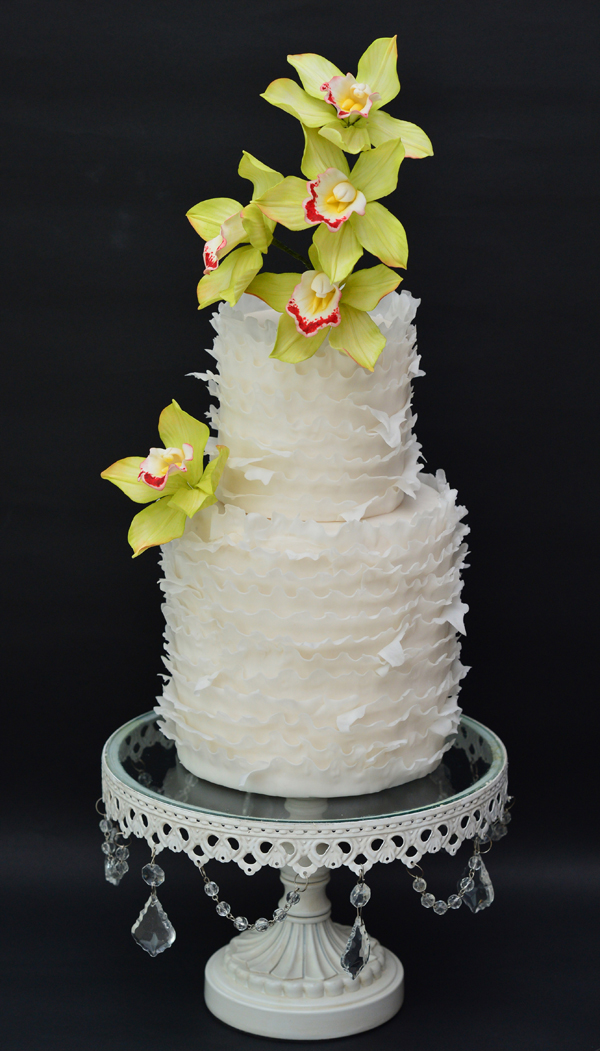 Tiered fondant Ruffle cake with yellow gum paste sugar flowers