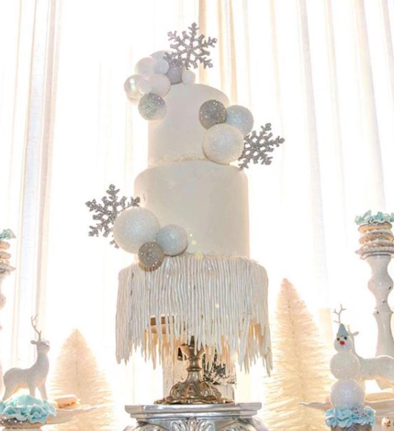 White fondant cake with silver snowflakes