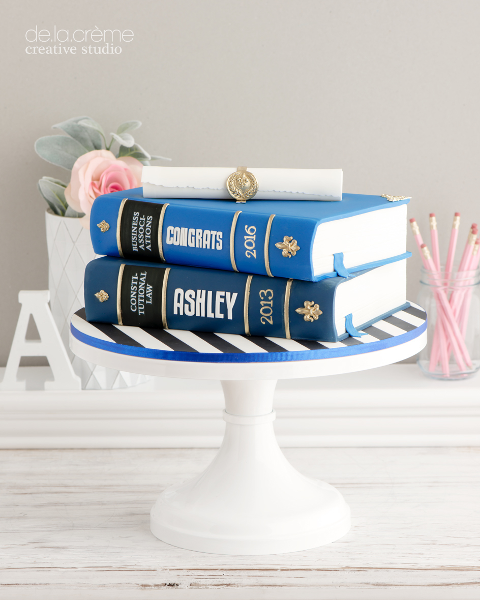 Stack of books graduation cake