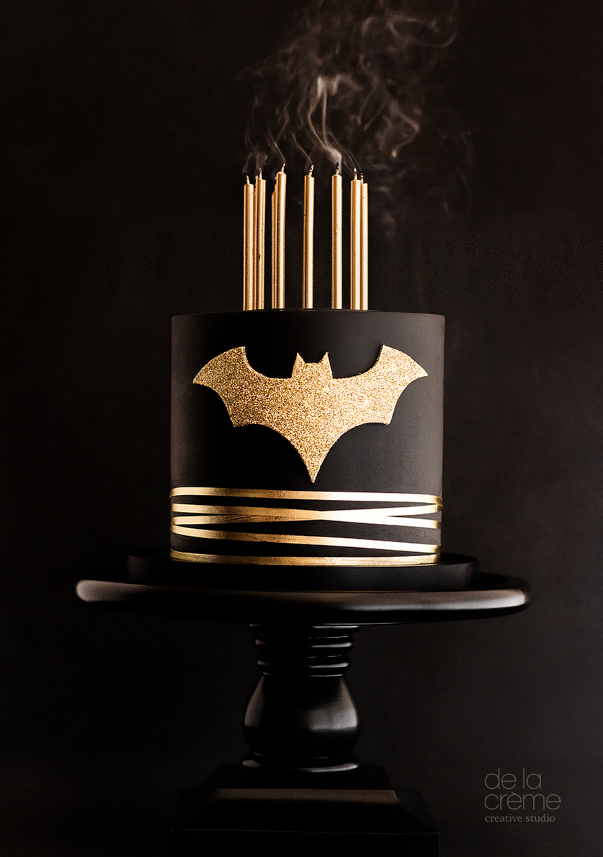 Black and gold glamorous batman themed cake