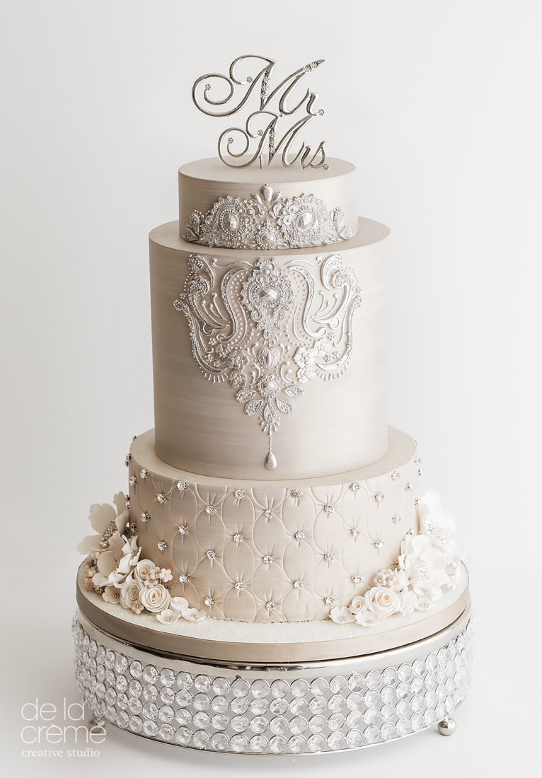 Ivory jeweled wedding cake