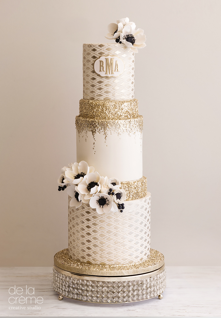 Ivory fondant wedding cake with gold sparkle