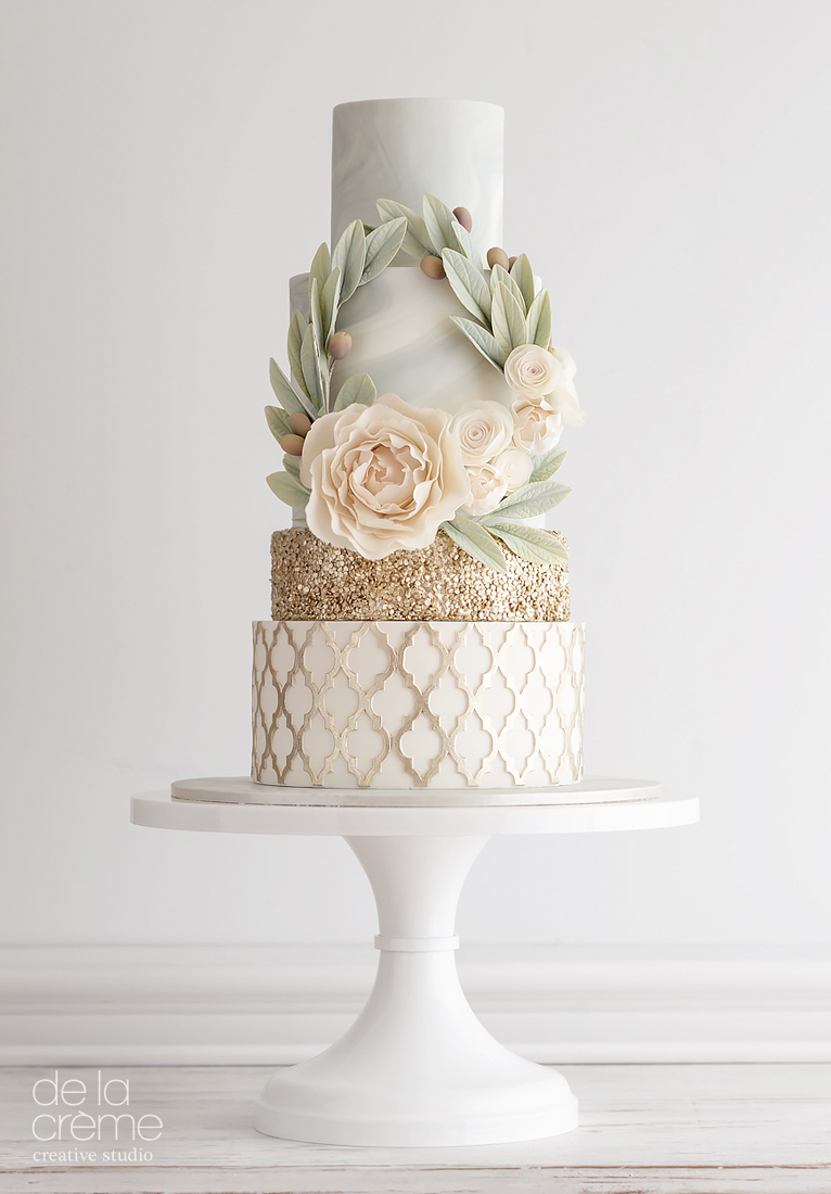 Gold & Peach wedding cake with a eucalyptus wreath