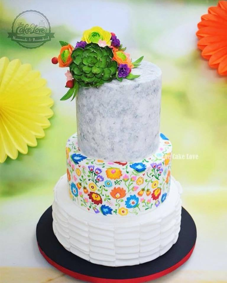 Gray and white fondant cake with succulents