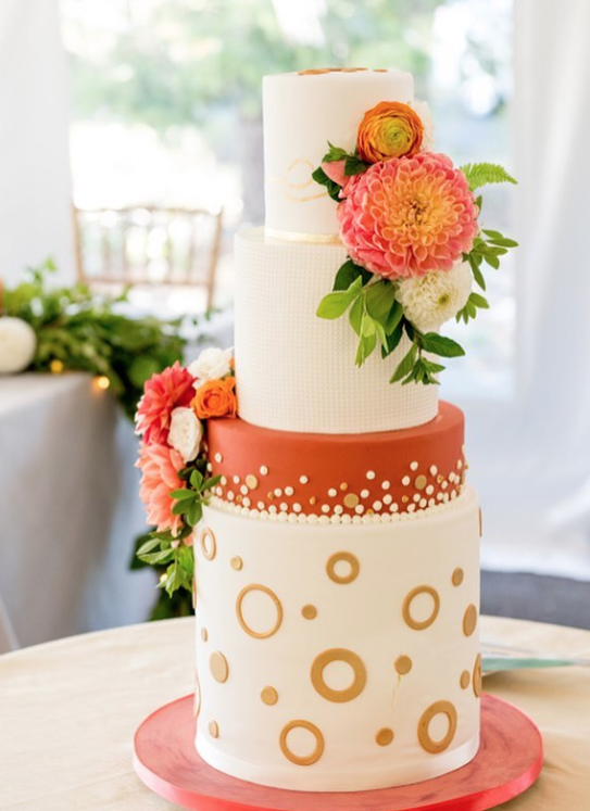 Orange and white circle pattern wedding cake