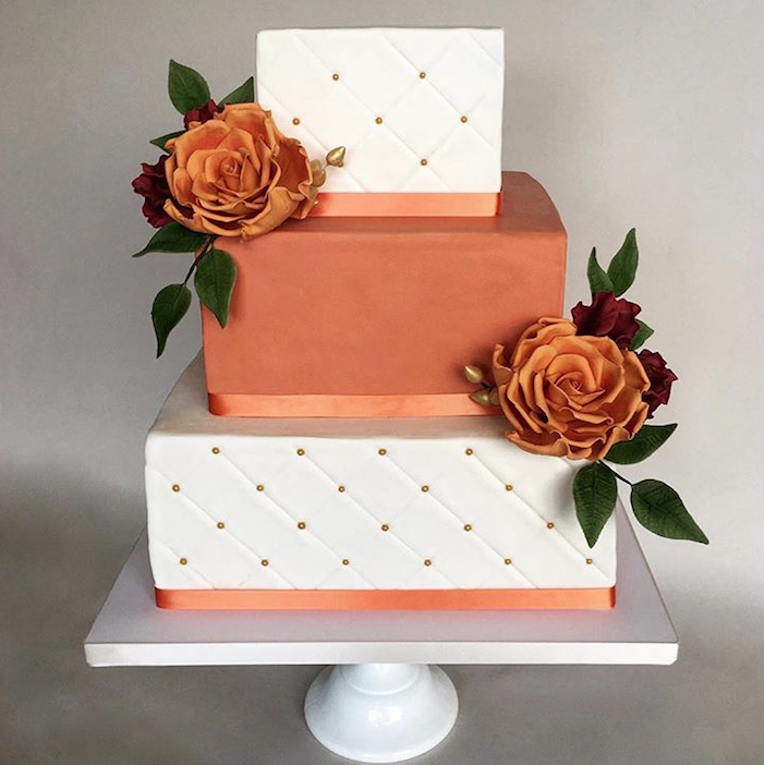 Burnt orange and white fondant wedding cake