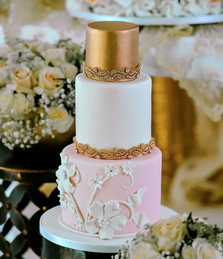 Light pink, white and gold fondant wedding cake