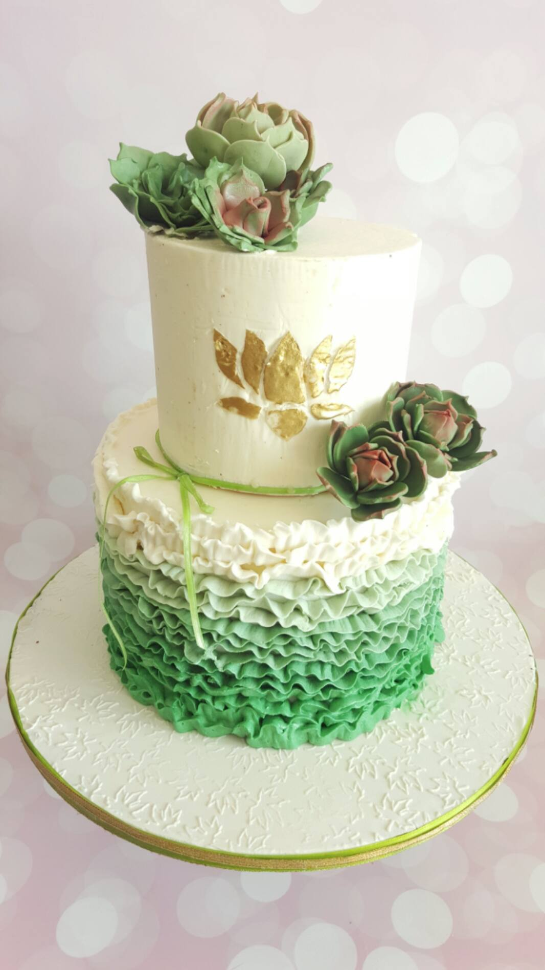 Green and white ombre cake with succulents