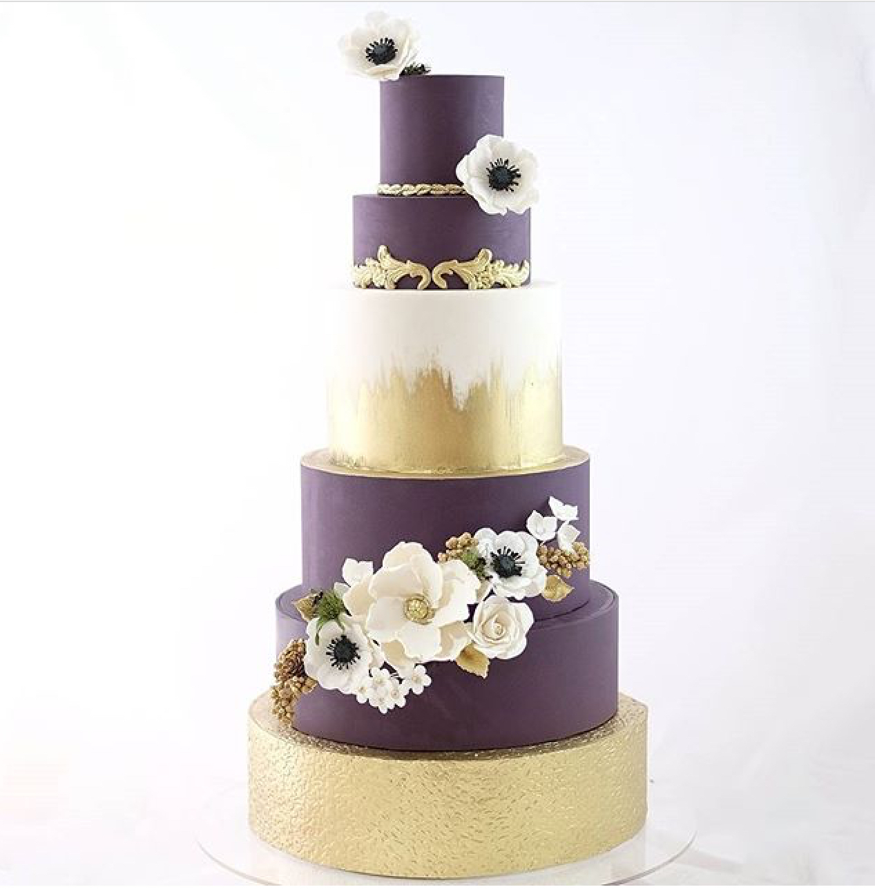 Purple and gold fondant wedding cake