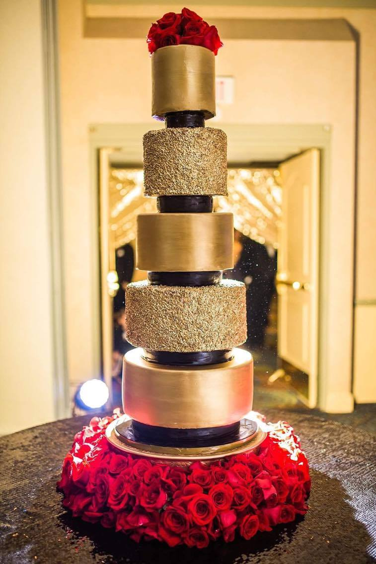 Tall tiered gold fondant wedding cake