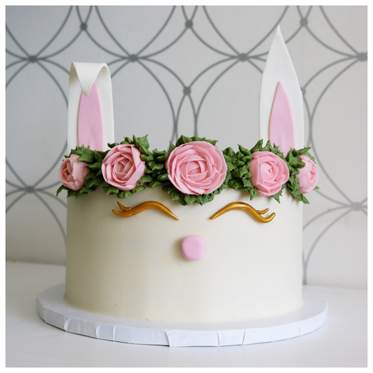 Ivory bunny fondant cake with ears and pastel sugar flower wreath
