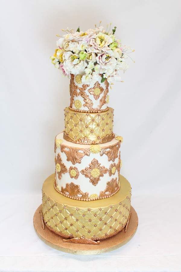 Gold Baroque styled fondant wedding cake