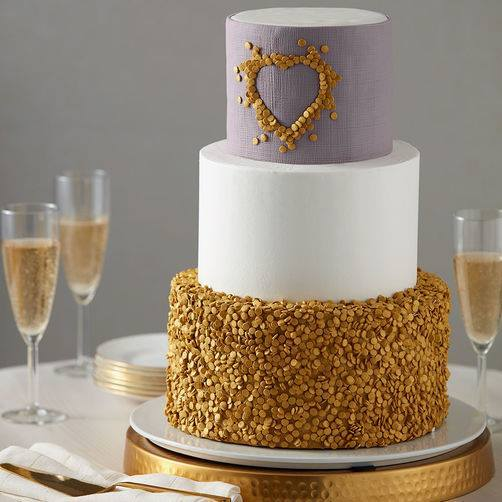 Gold sequin and white wedding cake