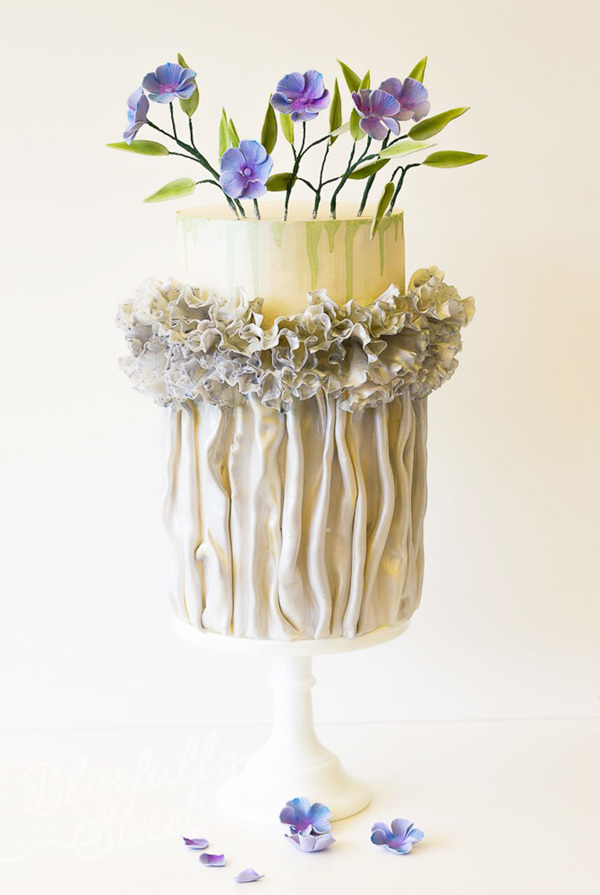 White fondant cake with lavender sugar flowers