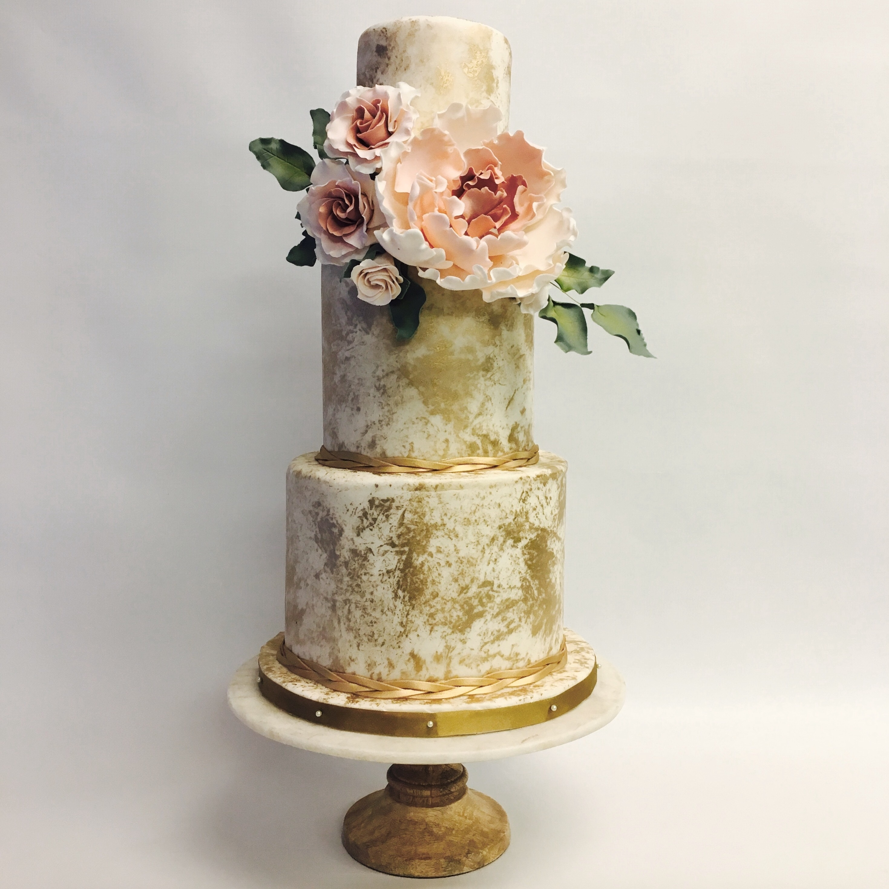 Ivory fondant wedding cake dipped in gold dust