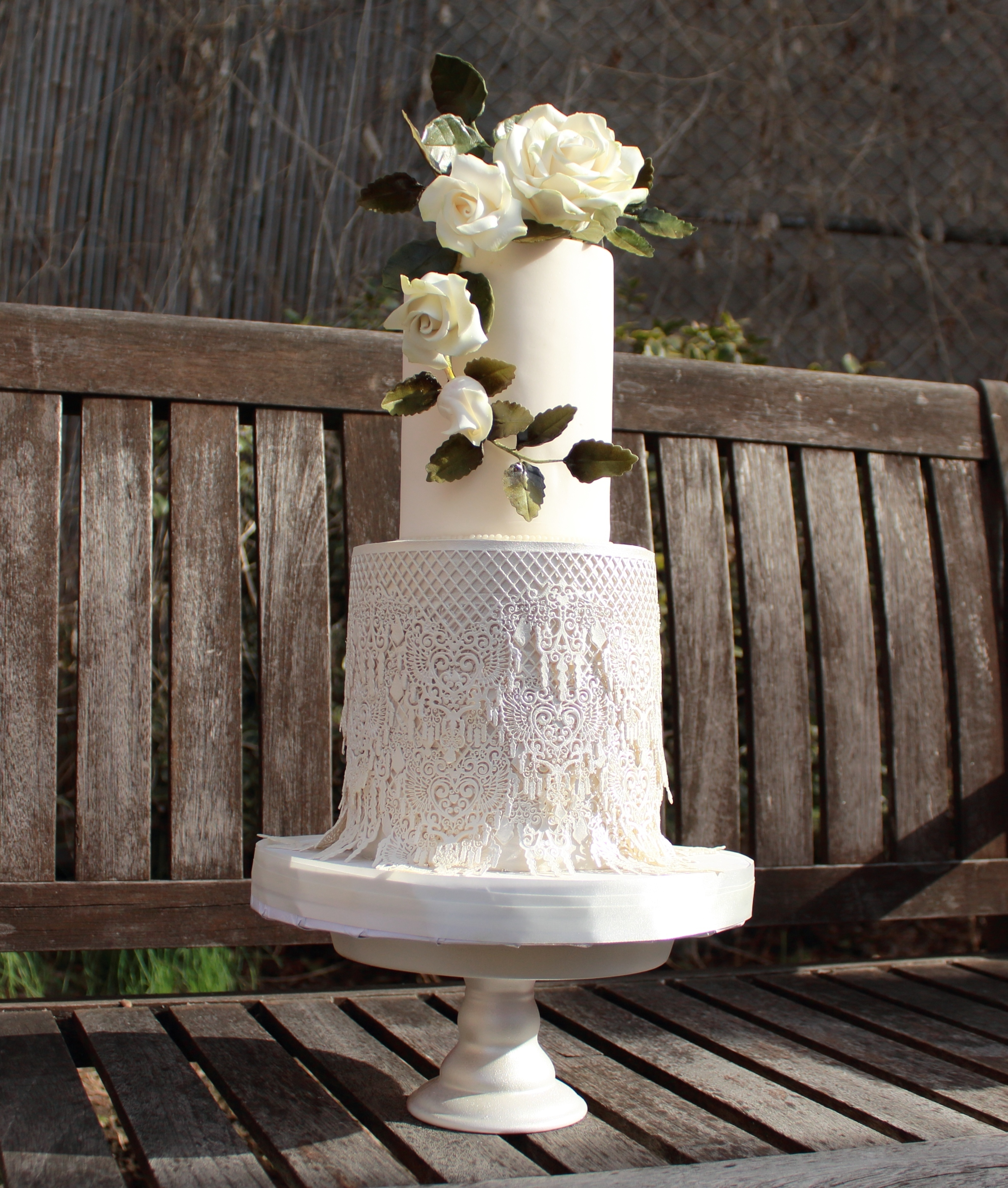 White fondant boho fringe wedding cake