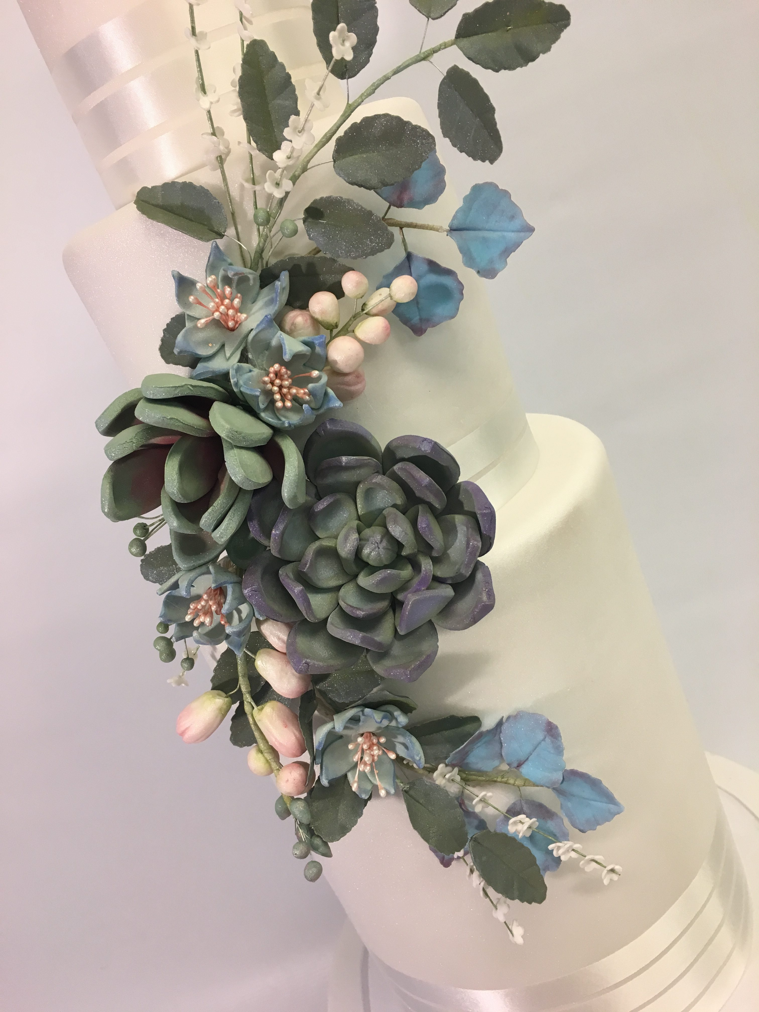 White fondant wedding cake with gum paste succulents