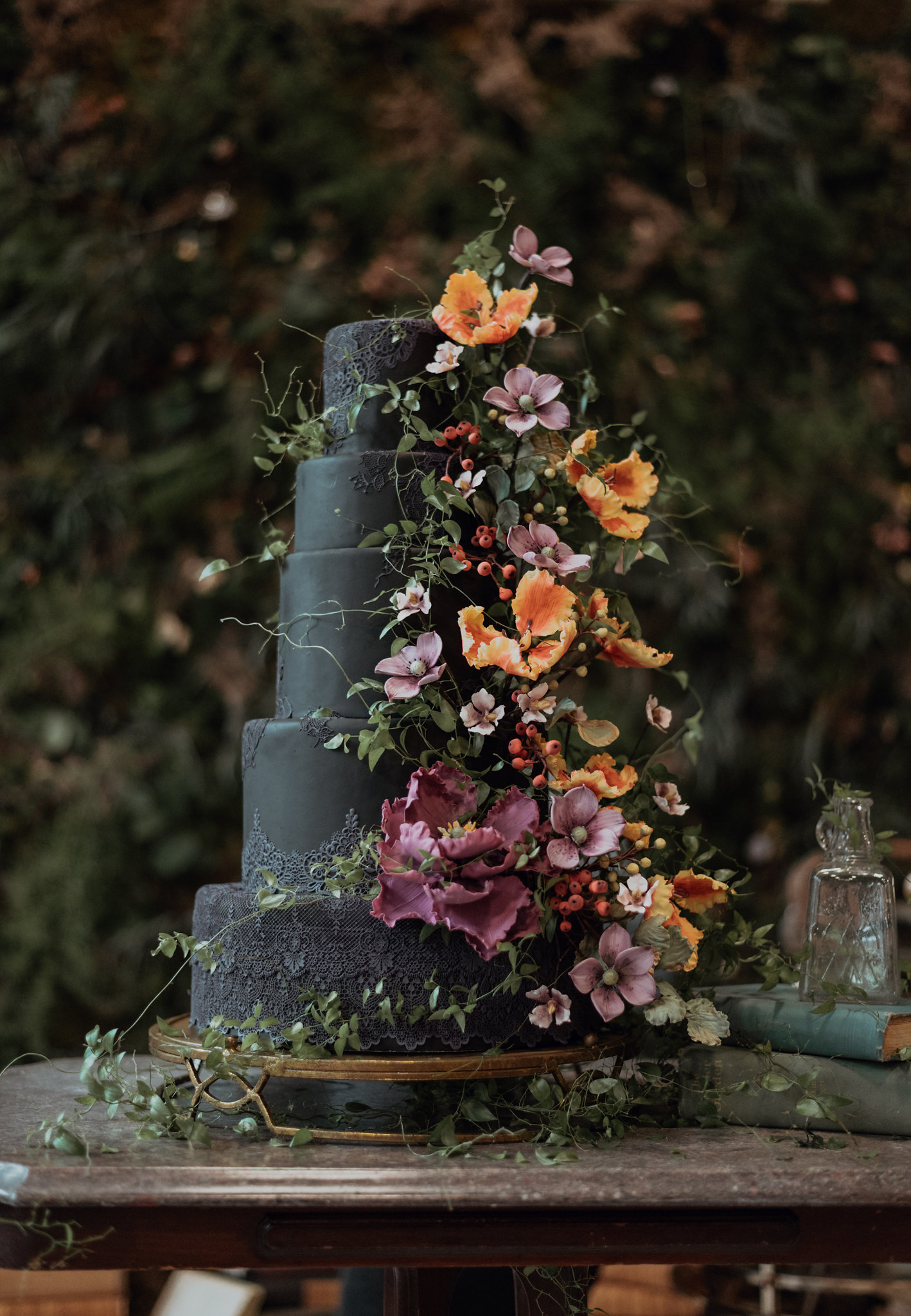Black wedding cake with blackberry sugar flowers