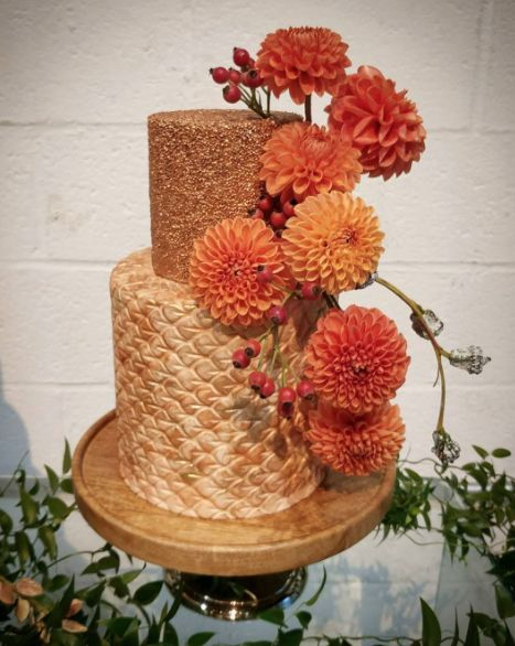 Gold fondant wedding cake with orange sugar flowers