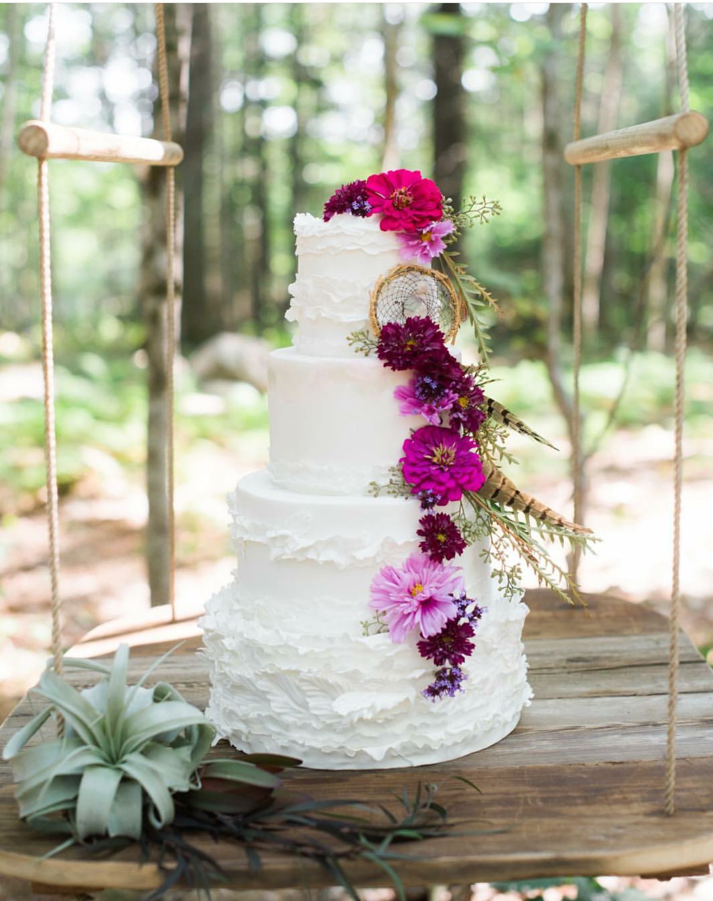 White boho wedding cake with dreamcatcher and sugar flowers