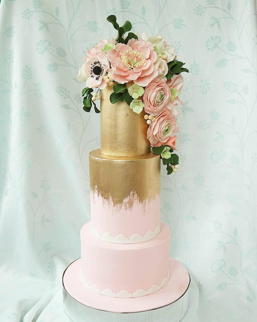 Baby pink wedding cake with gold leaf