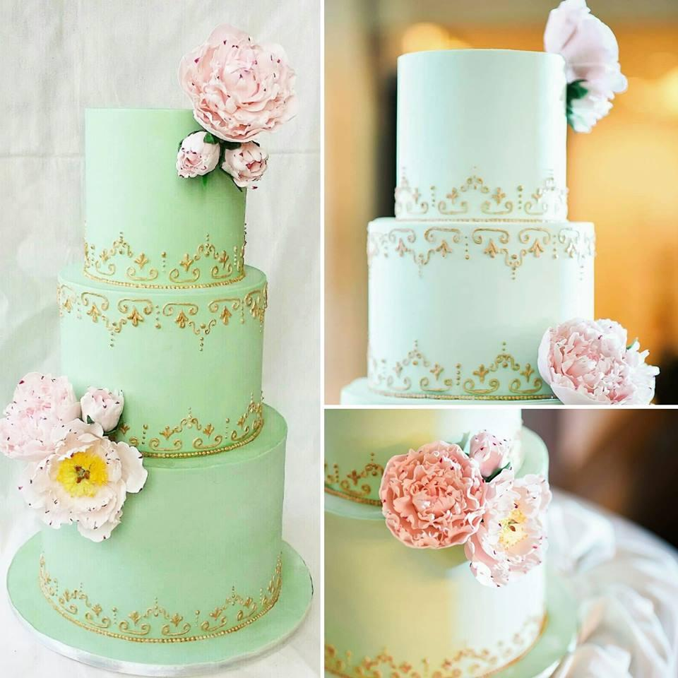 pastel green wedding cake with gold trimmings