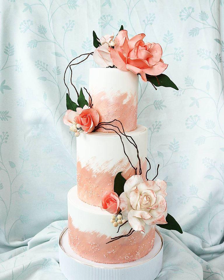 White with peach sugar flowers wedding cake