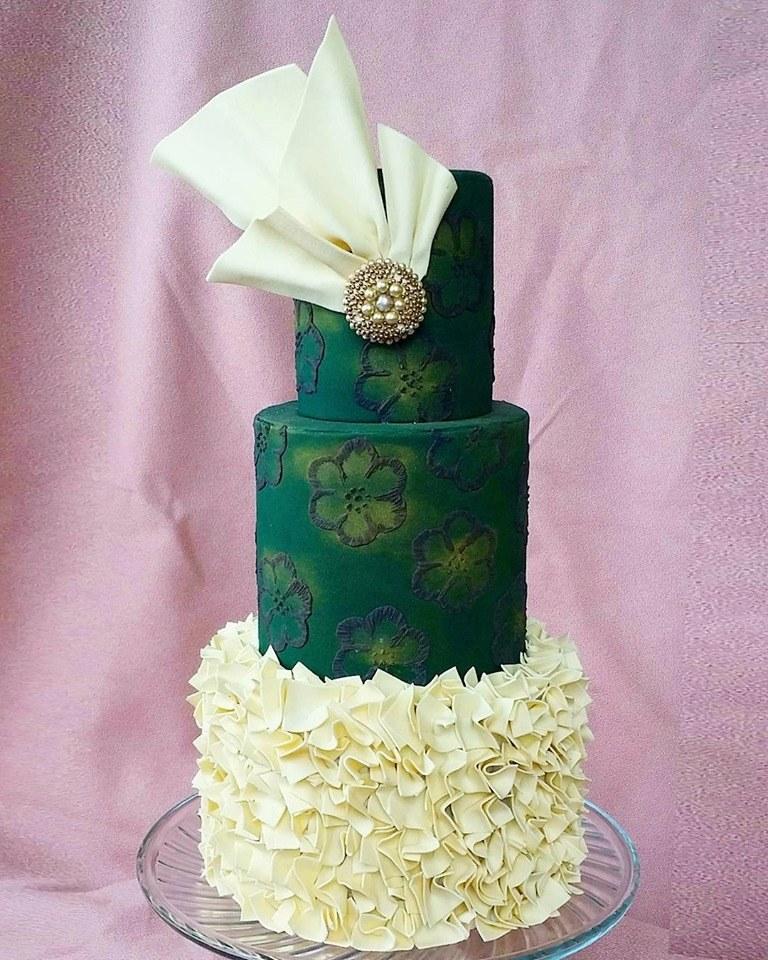 dark green wedding cake with ivory ruffles