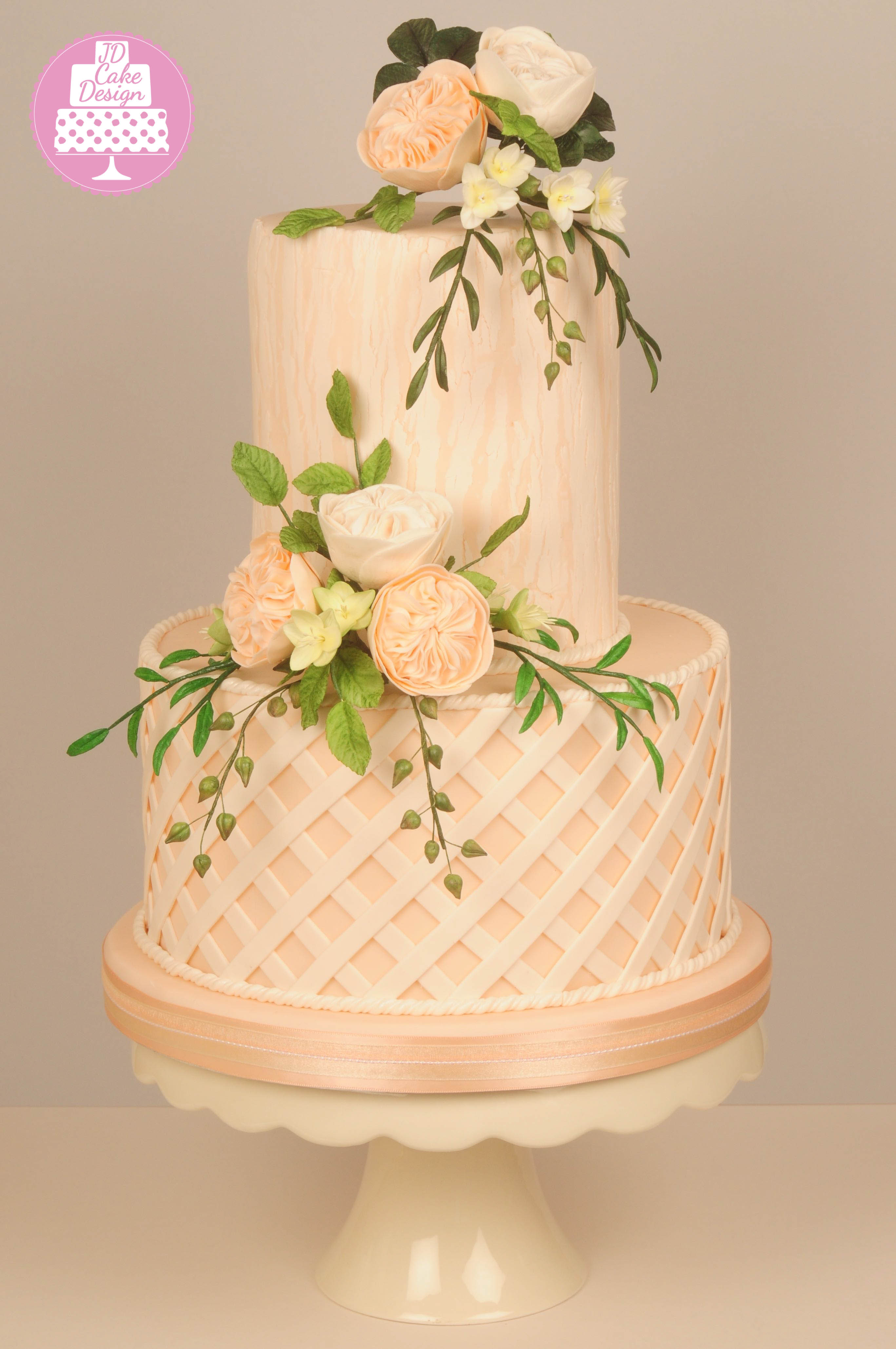 Peach and white fondant wedding cake