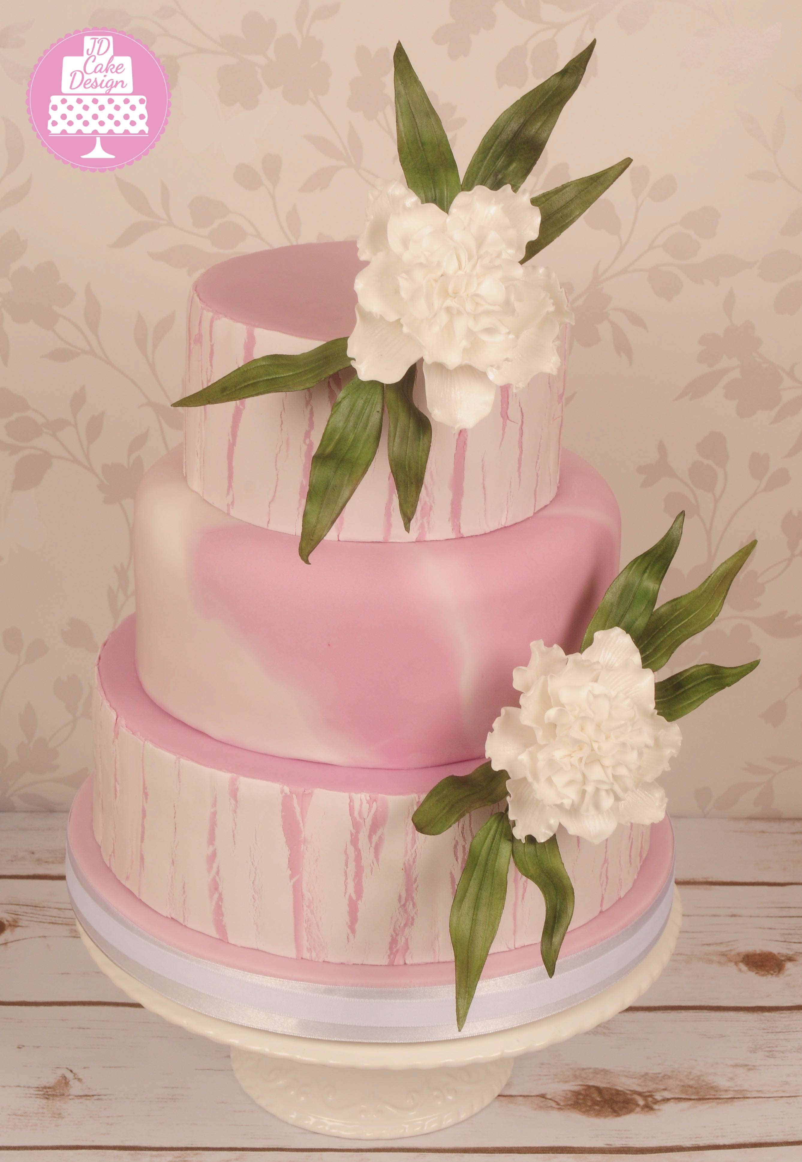 Pink and white marble wedding cake