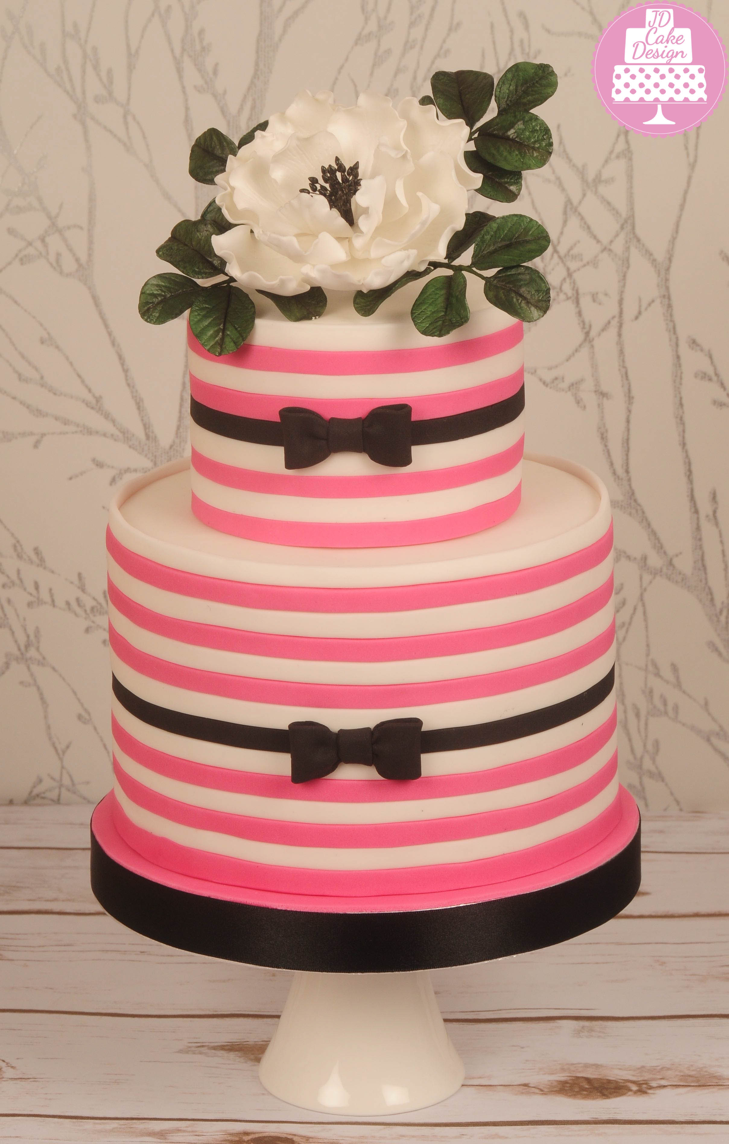 Pink and white bow tie wedding cake