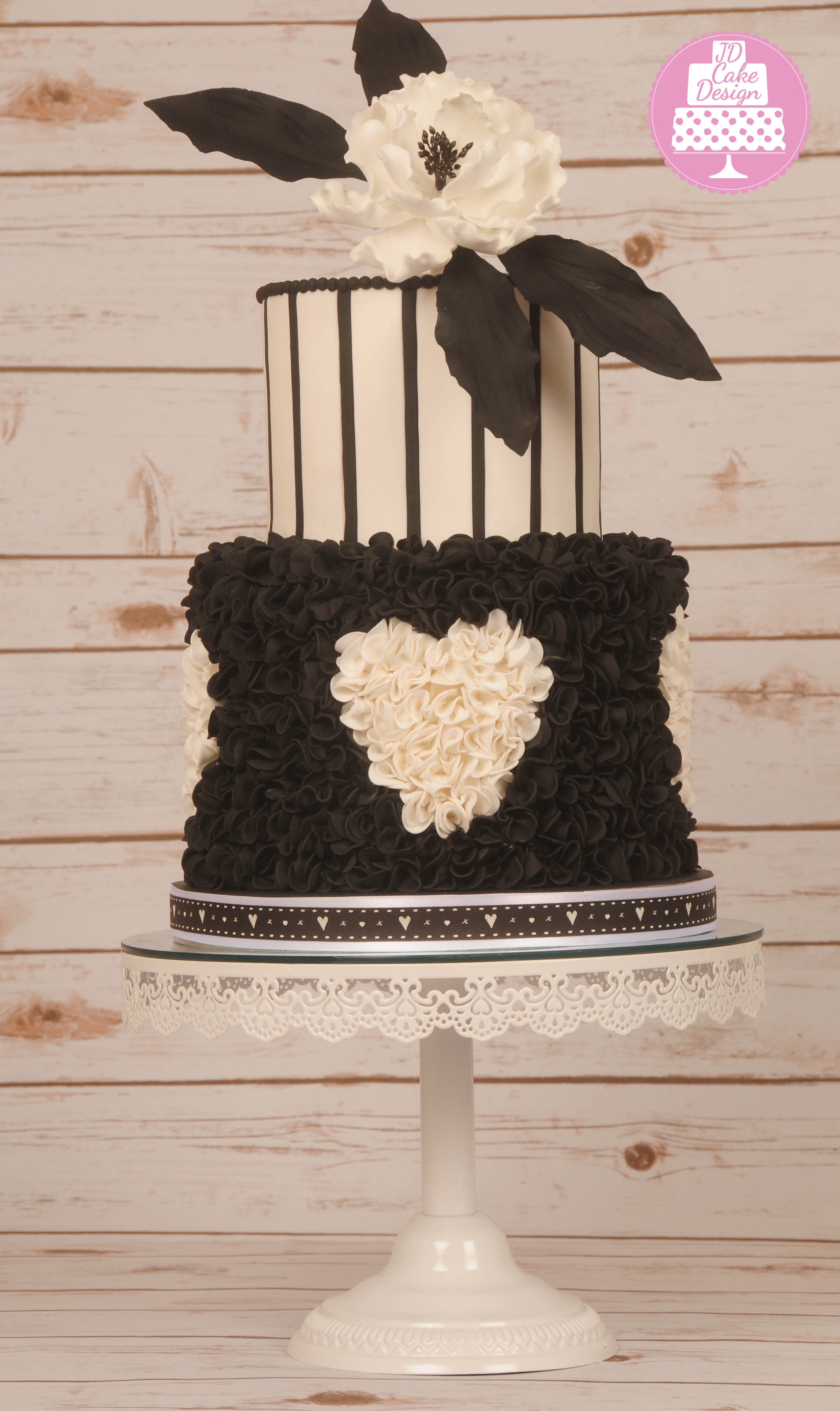 Black and white ruffle heart wedding cake