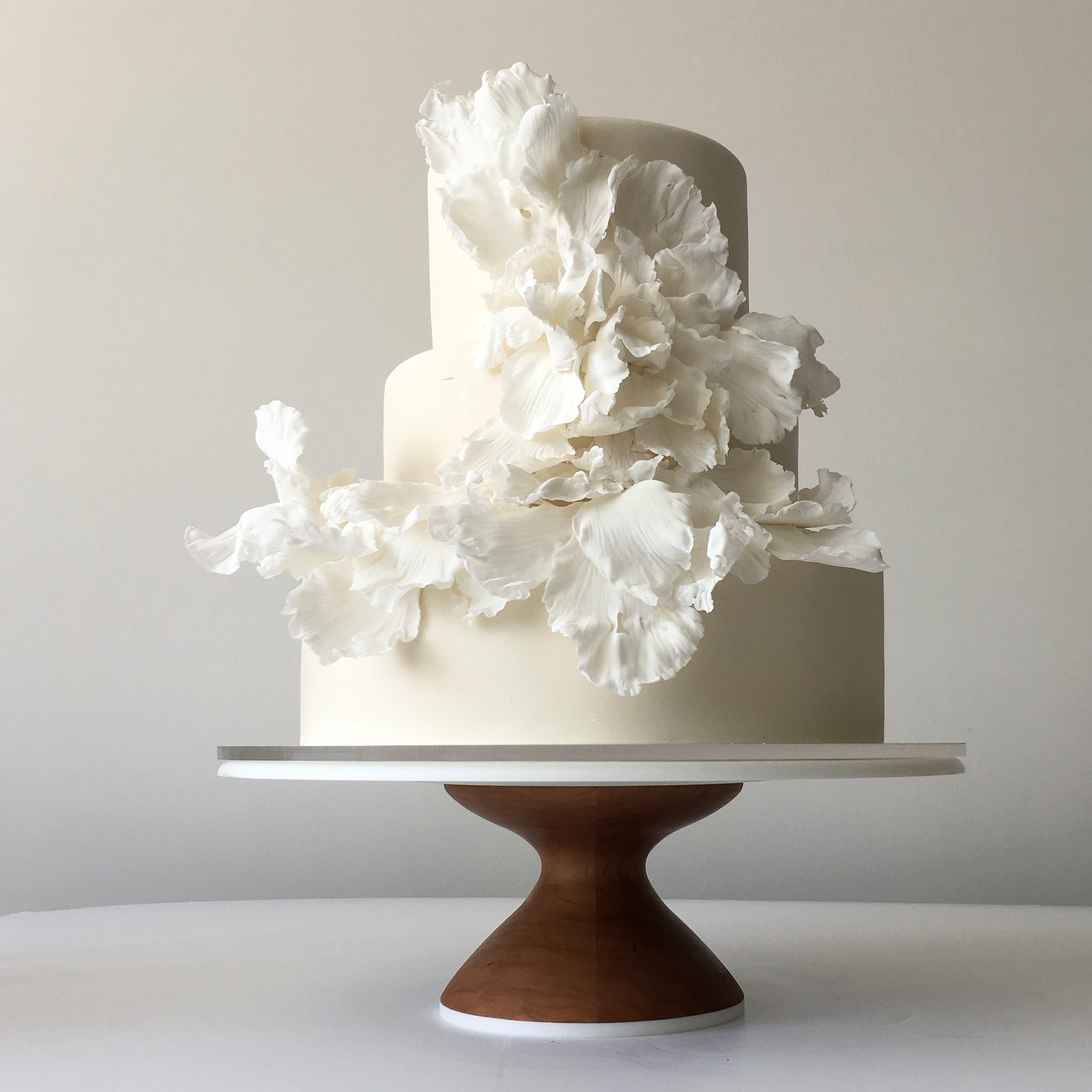 All Ivory wedding cake with frilly sugar flowers