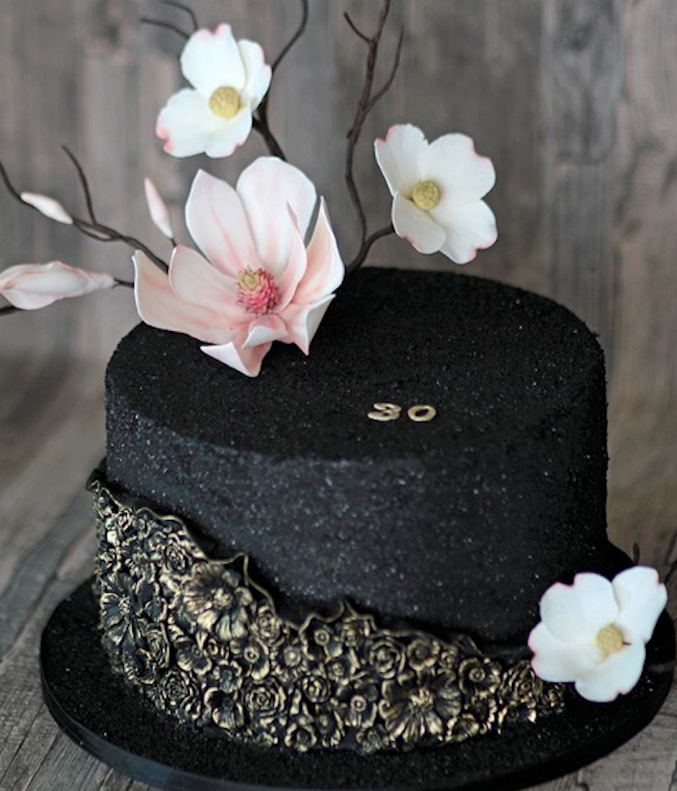 Black fondant cake with  bas relief flowers