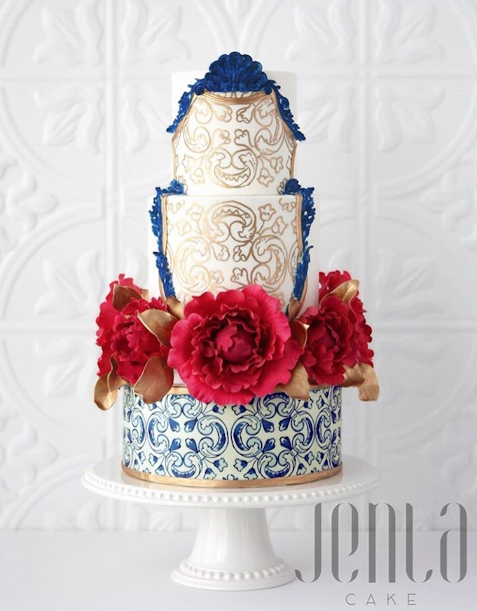 Batik patterned wedding cake with red sugar flowers
