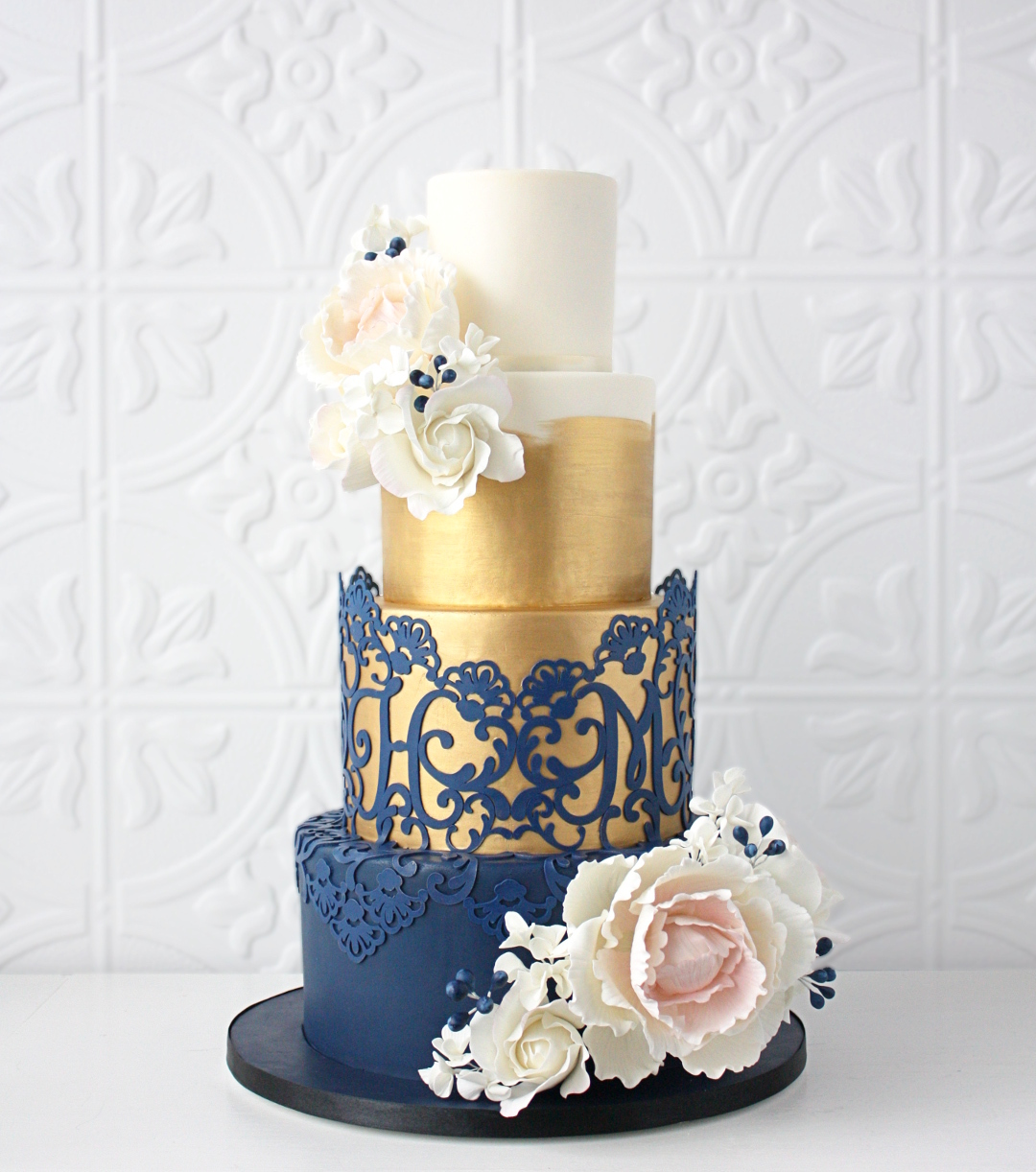 gold and navy blue fondant cake