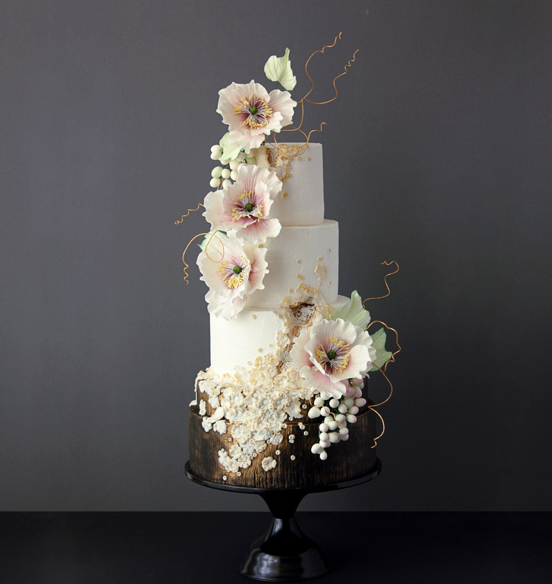 Ivory fondant wedding cake with sugar flowers