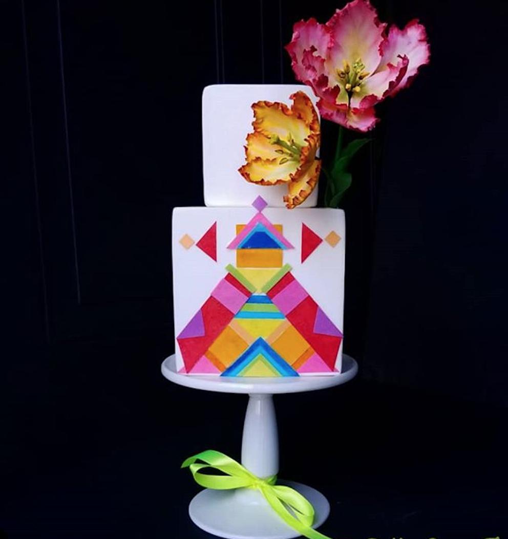 Neon colored geometric patterned fondant wedding cake