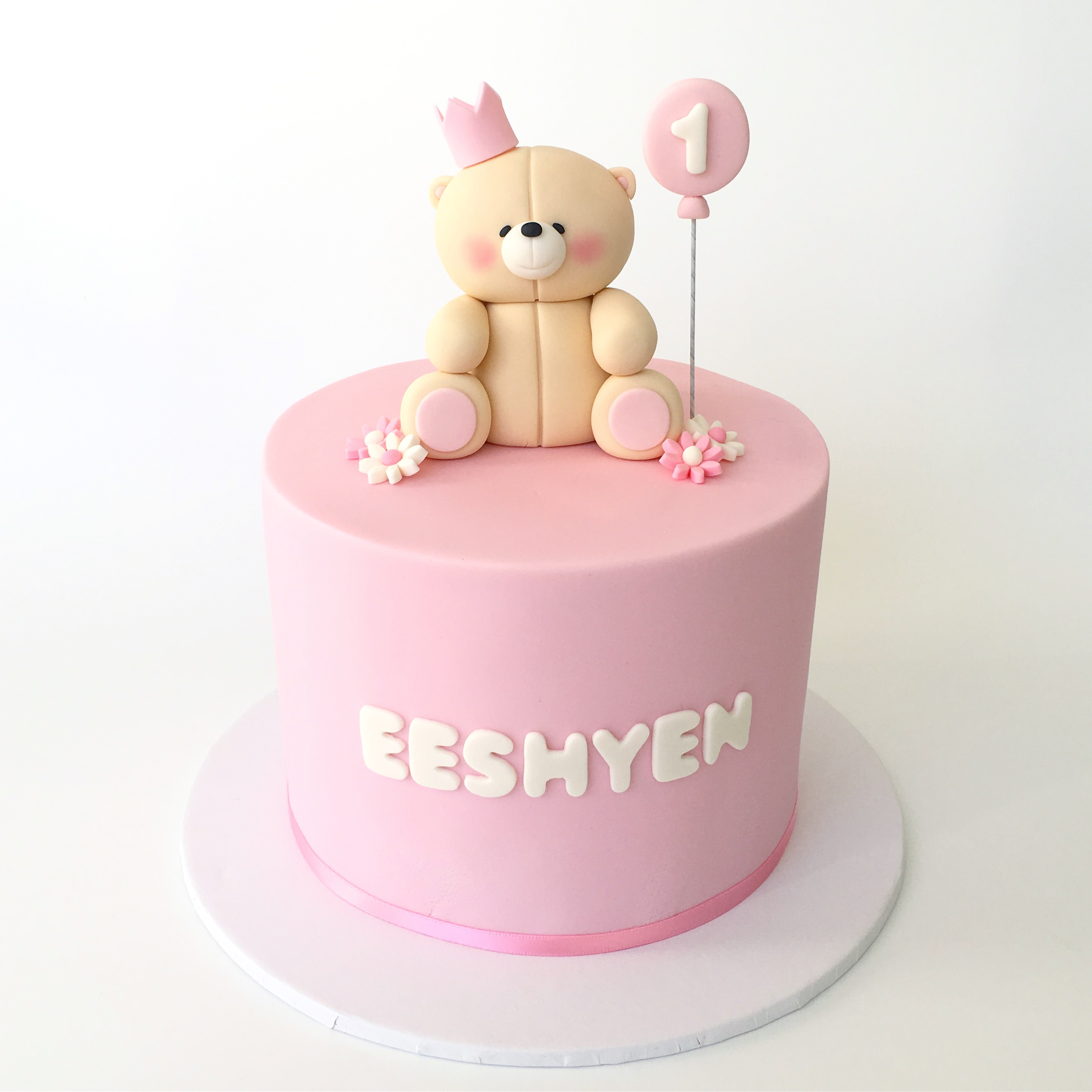 Pink teddy bear first birthday cake