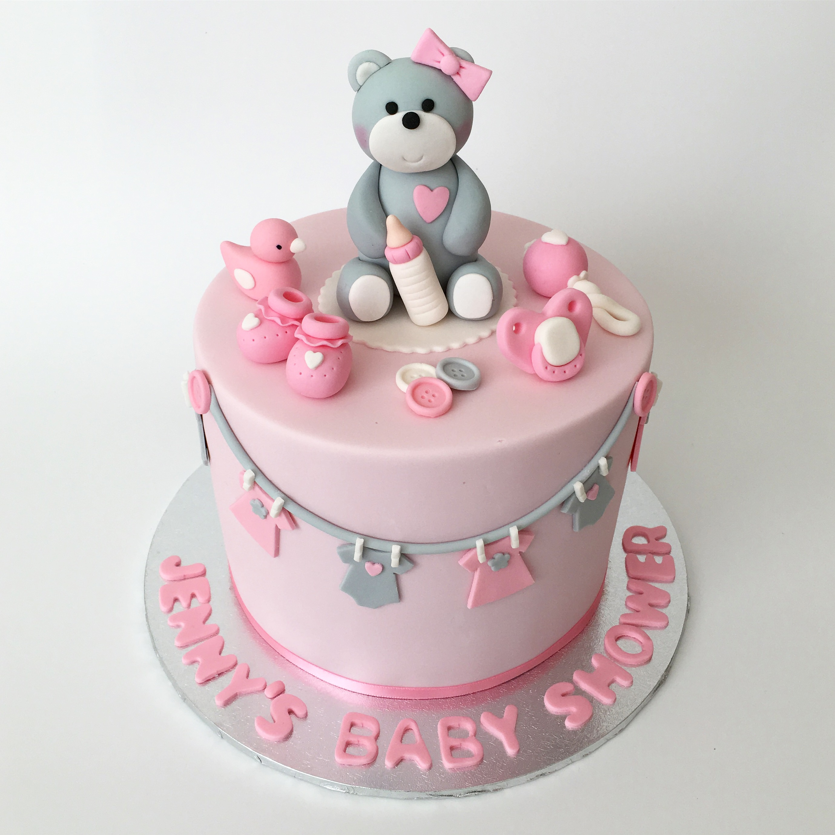 Pink baby shower cake with teddy bear topper